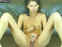 skinny asian milf rubbing her snatch