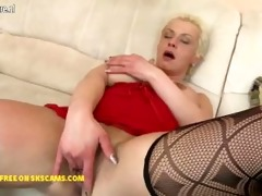 wicked housewife playing with her glass fake penis