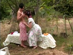 aged milf takes younger slut&s top off and