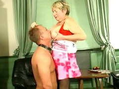 corpulent golden-haired russian granny plays with