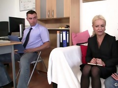 two men share old blond in the office