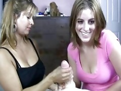blond milf shows her daughter how to do handjob