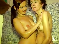 youthful girl and old granny masturbate together