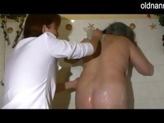 obese granny gets her hairy bawdy cleft washed by
