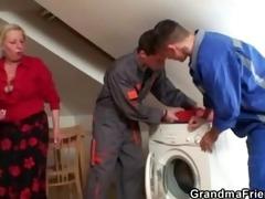 two repairmen bang breasty grandma from both ends