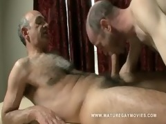 hairy mature receives a massage and copulates the