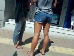 in front of the atm- not mother &; not her
